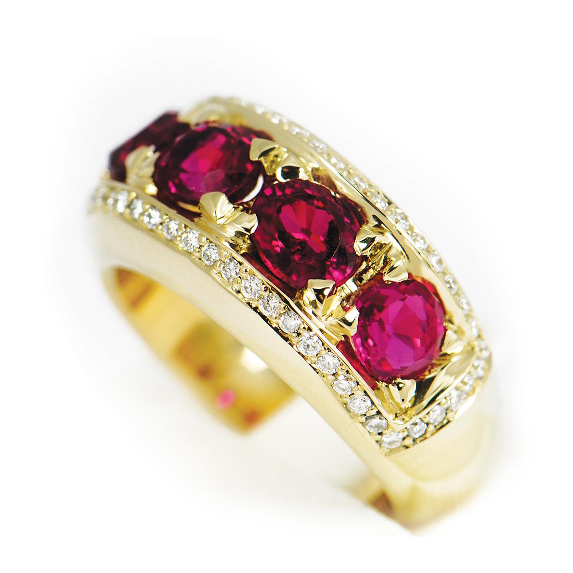 Pierścionek ze złota próby 750, wysadzany rubinami oraz brylantami.